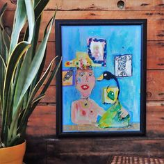 This painting is mixed media on a framed canvas. It is ready to be hung in your home.