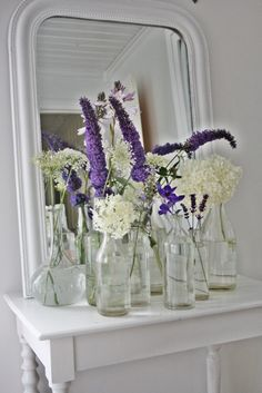 source: Vibeke Design ~ beautiful floral arrangement Purple and white stems in glass milk bottles