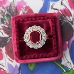 Fantastic vintage ruby & diamond halo ring <3