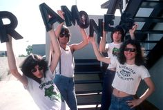 LR Joey Ramone Dee Dee Ramone Johnny Ramone and Tommy Ramone of the rock and roll band 'The Ramones' pose for a portrait holding letters that spell...