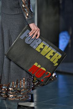 Phrase Clutches — Oversized envelope clutches have been riding strong as a trend for a few years, but they're now coming emblazoned with phrases. Quippy, sarcastic, and sometimes nonsensical, these bags let you put your mouth where your money is. Kenzo.
