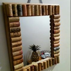 Wine cork mirror- might be a great way to use all those wine corks I've been saving