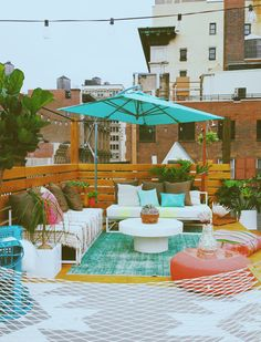 Modern roof city garden. Love the pops of colour and those benches could easily be DIY with pallets.