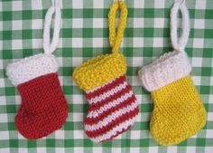 Free knitting pattern!  My little Christmas stockings make super decorations for the festive season.  They are knitted flat (not in the round) so are easy for beginner knitters to make, and use only small amounts of yarn.  The free pattern is available for instant download from the fluff and fuzz Craftsy store