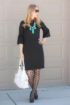 outfit inspiration: black dress, polka dot tights, statement necklace