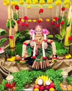 "Varalakshmi Vratham or Varalakshmi Vrat is the festival to appease Goddess Lakshmi, the consort of Lord Vishnu. Vara means that ""boon"" and Lakshmi means ""Goddess of Wealth"". Housewarming Decorations, Diwali Decorations, Stage Decorations, Indian Wedding Decorations, Flower Decorations, Decor Wedding, Wedding Colors, Wedding Flowers, Rangoli Designs Flower"