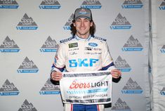 Ryan Blaney Photos - Ryan Blaney, driver of the #21 SKF/Quick Lane Tire & Auto Center Ford, poses with the Coors Light Pole Award after qualifying for the Monster Engergy NASCAR Cup Series Can-Am 500 at Phoenix International Raceway on November 10, 2017 in Avondale, Arizona. - Phoenix International Raceway - Day 1
