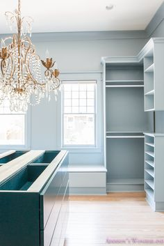 Tour our new master closet... a bold powder blue custom closet features a teal island and crystal chandelier.