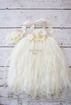 Chiffon Ivory Dress Perfect to wear as a flower girl dress!  Includes headband and dress Also, available in champagne.