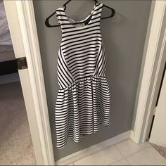 Adorable stripe dress I got this dress from a boutique. Super adorable and stripes. Flares at the waist. Tinley Road Dresses
