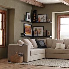 west elm sectional and frames...love the flaoting lacquer frames