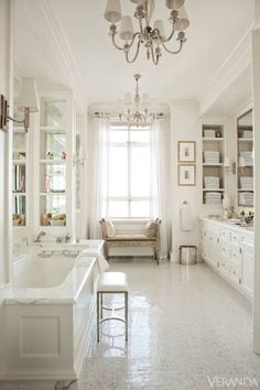 Tub, fittings, stool and tiles, Waterworks. Custom cabinets. Pillows and Victorian bench, æro. Sconces, Thomas O'Brien for Visual Comfort. Vintage chandeliers.