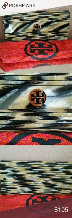 Rare Tory Burch Clutch Purchased this from Neiman Marcus and is now a retired piece. Gorgeous is an understatement.  Very fashion forward! In great condition, does have some slight peeling as pictured at the top of the bag but I'm positive can be fixed  (glue?) Dust bag included  Love this bag💕 Tory Burch Bags Clutches & Wristlets