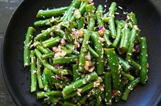 Fresh green beans, blanched and toss with a balsamic vinaigrette, red onions, basil, and Parmesan.