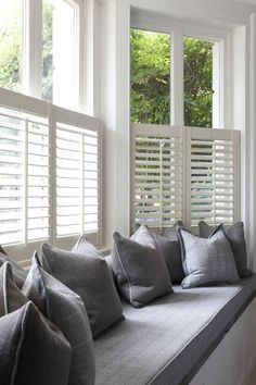 On trend grey interior with white basswood cafe style shutters