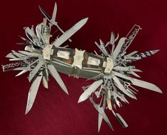 "This mammoth multi-tool was created in Germany by John S. Holler of the Holler Firm in 1880, it actually predates the Swiss Army Knife by ten years.  Holler's spectacular knife is equipped to perform 100 different functions:  ""It has a serrated blade, dagger blades, shears and scissors, an auger, a corkscrew, saws, a lancet, button hook, cigar cutter, pens and pencils, mirror, and straight razor."