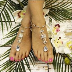 Gold foot jewelry. Gold crystal barefoot sandals for beach weddings. Our golden rhinestone sandals look great barefoot or with your wedding shoes. Make your dream wedding even more special with our st