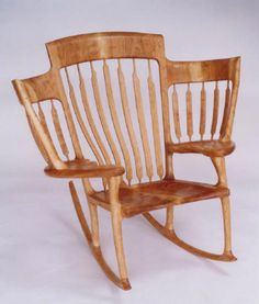 Beautiful chair and handy for holding lots of children at one time (Kid size chairs where the arm rests are.)