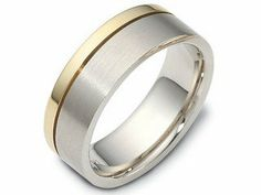 Men's Dora two tone wedding ring    Style number: A11772  The men's wedding ring pictured is made in a combination of 18kt yellow gold and white gold. The band pictured is made in part polished yellow gold and part matte satin finished white gold. The white gold section is wider than the yellow gold section. The ring pictured measures 7.5mm wide.    This wedding ring is part of the Dora brand of wedding rings. The Dora code for this ring is F1810.    You can order this ring as it is…