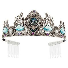 Ariel Tiara for Kids | Disney Store Your little princess will shine under the sea of dazzling jewels on this Ariel Tiara. Swirling silver metal surrounds a sculpted seashell, creating waves of joy and crowning off her look in royal style.