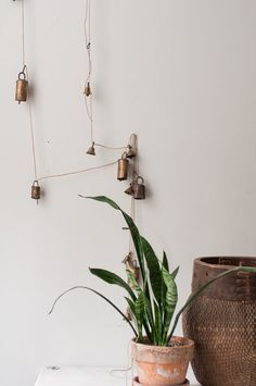 If you have antique bells stored away, take them out and hang them on your wall for a simple old-age look.