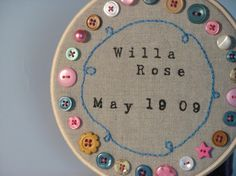 The buttons aren't to my taste, but I LOve the text. Would love to attempt to embroider their birth dates and weight.