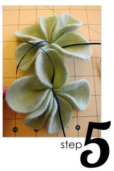Here are the details on how to felt  the wool ( a different method) and how to make the flowers for the scarf
