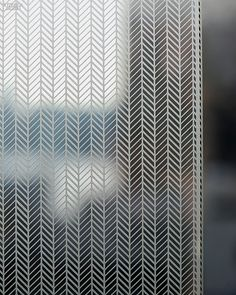 34 Functional Building Products | Etch annealed glass panel in Reflect by Carvart.