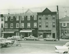 Businesses on Railroad Avenue in 1962.  Haddon Cigars, Town & Country Tailors, Hegarty's Pub.  Charles N. Mead's dry goods store, Carroll and Woolard's Plumbing and Sigmund & Klump's Boarding and Restaurant once occupied this block. Part of #Greenwich Library's Local History Photo Collection.