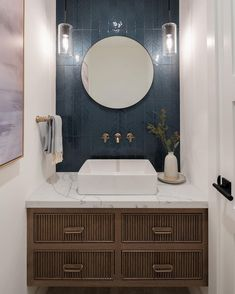 """Blueline Custom Cabinets on Instagram: """"Floating reeded vanity done in a custom stain fits perfectly in this powder bath for guests. Photographer @kuohphotographyinteriors . .…"""" Floating Vanity, Kitchen Tile, Custom Cabinets, Backsplash, Mirror, Bathroom, Glass, Modern, Furniture"""