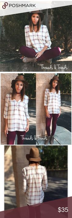Plaid Buttoned Blouse Beautiful fall plaid print blouse. 3/4 sleeves & three buttons in the chest. Made of polyester.          Plaid shirt (polyester) Small Bust 38 Length 28  Medium  Bust 40 Length 29   Large Bust 42 Length 30 Tops Blouses