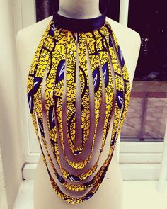 African WAX print fabric necklace This piece can be worn on any clothing: dresses, t-shirts etc. This necklace is the little thing that will each of your outfits. Wash it by the water with a little SOAP if you mess up. African Fashion Designers, Latest African Fashion Dresses, African Print Dresses, African Print Fashion, African Wear, African Attire, Africa Fashion, African Style, African Shirts