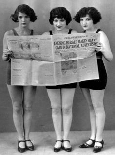 Women from the 20's reading the newspaper and looking independent. Bobbed hair was becoming popular as women realized their independence and equalitites to men.