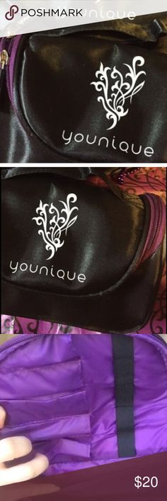 Younique Cosmetic Bag black w purple wipes clean Younique Cosmetic bag retired new authentic wipes clean has straps inside to hold brushes, or liners Brand New Authentic Retired younique Makeup Brushes & Tools