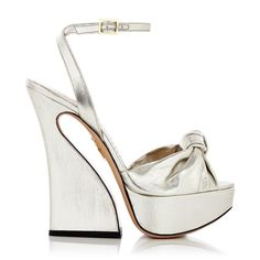 87ec6d134933e Try a new silhouette with Vreeland. In silver lamé with a feminine knot  detail and