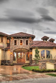 like the doors and how they look into backyard, like the roof and stone/stucco combo
