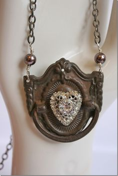 by Natalie Hansen...an antique metal drawer pull, with pearls and a rhinestone heart.