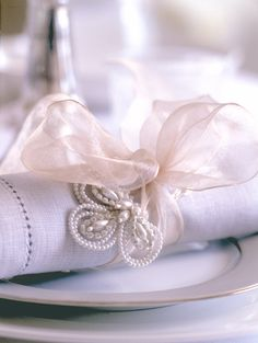 Beautiful display, love, love the sheer ribbon with the linens ~❥ just the ribbon...not the pearl add on