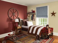 Benjamin Moore Paint Colors - Red Kids' Rooms Ideas - Cowboy-Friendly Red Kids' Bedroom - Paint Color Schemes . . . . . An accent wall of Hot Apple Spice (2005-20) creates cozy warmth and comfort. . . . . . Accent Wall (behind head of bed) - Hot Apple Spice (2005-20); Wall (by window) - Monroe Bisque (HC-26); Accent (window shade) - Black Pepper (2130-40).