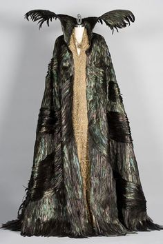 This is one of the first dresses they made for queen Ravenna. It has feathers on the cloak because Ravenna turns into the birds in one scene. The large collar gives the queen her evil appearance.