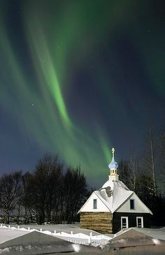 The Northern Lights or aurora borealis fill the western sky Friday, March 9, 2012, above the Russian Orthodox Saint Nicholas Memorial Chapel in Kenai, Alaska Photo: AP