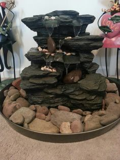 DIY water fountain for sweet dreams each night...rock fountain from Lowe's ($99), river rock from the river ($0), heater pan from Lowe's ($20)...spray painted the heater pan to blend with the rocks/added water...DIY!