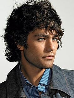 Adrian Grenier. I love how his blue shirt picks up the color of his eyes. And the curly hair gets me every time!