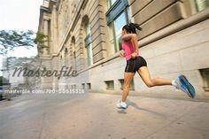 Runner Running Down City Street - Stock Photos : Masterfile