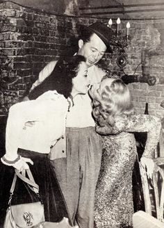 Glamour girls Hedy Lamarr & Marlene Dietrich give director Billy Wilder a surprise by sharing a passionate kiss on the set of A FOREIGN AFFAIR 1948. Marlene's bisexuality was well known in Hollywood. Her group of girlfriends  was called her 'sewing circle'. Marlene & her husband had an 'open marriage' that worked. They shared their lovers letters, & all went off to Europe each year, daughter Maria & lovers in tow.   (please follow minkshmink on pinterest) #kiss #marlenedietrich #hedylamarr