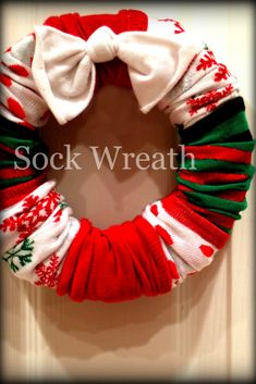 Christmas Sock Wreaths: 4 pairs of socks bought from the dollar store. You can also buy different theme socks- Valentines, Halloween, Easter, Fall. GREAT idea!