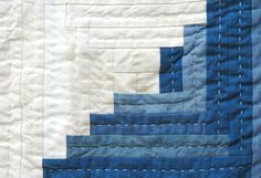 Blue log cabin detail with interview of Maura Ambrose from Folk Fibers