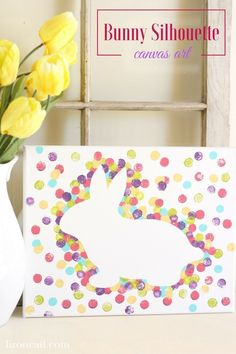 This Easter bunny canvas art is a fun kid craft that is easy to do and is perfect to add to your Easter home decor. Download the free bunny silhouette cut file. #DIYHomeDecorPainting #DIYHomeDecorCanvas #kidscrafts