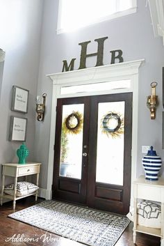 Tips for creating and accessorizing your dream entryway foyer with gray walls, dark hardwood flooring and bold pops of color!