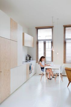 What's the modern answer to Mary Tyler Moore's Minneapolis studio apartment? Take a look at this masterfully planned mini loft located in a century-old res Home, Kitchen Design, Plywood Kitchen, Home Remodeling, House, Door Design, Kitchen Interior, House Interior, Kitchen Door Designs